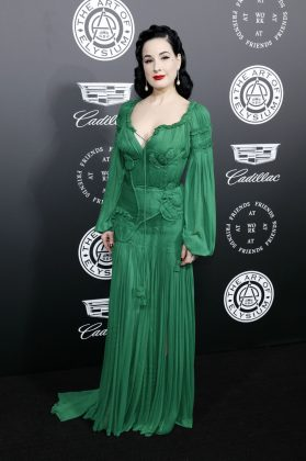 Dita Von Teese joined the 11th Art of Elysium Heaven Gala wearing a romantic emerald green dress with voluminous sleeves and hanging tassels. (Photo: WENN)