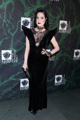 Dita payed tribute to Old Hollywood glam in a black velvet and lace gown with statement shoulder and birdcage veil at Bette Midler's 2017 Hulaween event. (Photo: WENN)