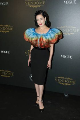 Von Teese attended the Vogue Party at the 2017 Paris Fashion Week wearing an interesting Jean Paul Gaultier featuring a voluminous floral-printed bodice. (Photo: WENN)