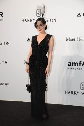 The American vedette kept an air of mystery at amfAR Milano 2016 in a black sequined dress and a high birdcage veil. (Photo: WENN)