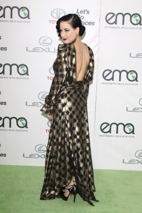 The burlesque dancer exuded old school glamour at the 2015 Environmental Media Awards in a gold dress that left her pallid back exposed. (Photo: WENN)