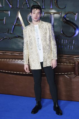 "Ezra attended the ""Fantastic Beast And Where to Find Them"" European premiere wearing black shoes and pants, topped with a dazzling ivory blazer with metallic vinery detailing. (Photo: WENN)"