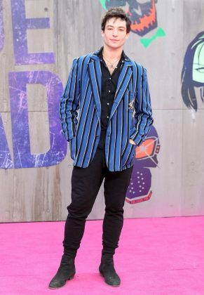 "Ezra Miller stole the show at the ""Suicide Squad"" premiere rocking a statement bright blue and black 80's-inspired striped blazer on top of an all-black outfit. (Photo: WENN)"