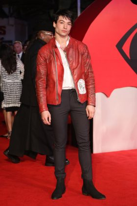 "The ""Justice League"" star attended the European premiere of ""Batman vs. Superman"" wearing a very fashionable burnt red zip-up leather jacket paired with tight black jeans. (Photo: WENN)"