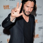 "2013—Keanu greeting his fans at the Toronto Film Festival premiere of ""Man of Tai Chi."" (Photo: WENN)"