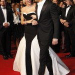 Ryan Reynolds making his beautiful wife crack up at the 2014 annual Cannes Film Festival. (Photo: WENN)