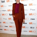 "Evan showed off autumnal color in a burnt orange suit paired with plum purple blouse for the TIFF premiere of her movie ""Into the Forest."" (Photo: WENN)"