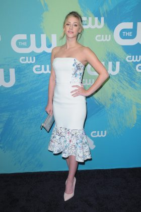 Reinhart rocked a Little-Mermaid inspired white dress with floral detailing by Yanina Couture at CW's 2016 upfronts. (Photo: WENN)