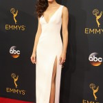 Emmy Rossum lightened up the Emmy's 2016 red carpet in a simple yet elegant white plunging evening dress with thigh-high slit. (Photo: WENN)
