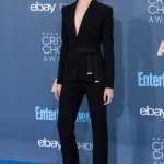 Evan Rachel Wood took the plunge in a revealing black Altuzarra suit tied at the waist at the 2016 Critic's Choice Awards blue carpet. (Photo: WENN)