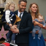 Blake and Ryan in mommy and daddy duty posing with their kids at the Hollywood Walk of Fame event honoring Reynolds. (Photo: WENN)