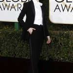 Wood paid homage to Marlene Dietrich and Victor/Victoria at the 2017 Golden Globes wearing a black tux by Altuzarra and white pussy-bow blouse. (Photo: WENN)