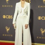 "The ""Westworld"" star lightened up the 2018 Emmys red carpet in a white cropped Moschino jacket, paired with long, wide-leg pants. (Photo: WENN)"