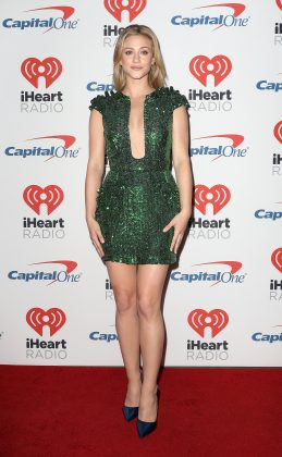 "The ""Riverdale"" star shimmered in a plunging emerald green Yanina dress completely covered in sequins at the second day of the 2017 iHeartRadio Music Festival. (Photo: WENN)"