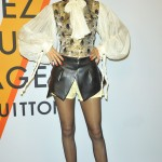The former Disney attended Louis Vuitton's art exhibition wearing a sophisticated cream blouse, leather and metallic brocade dress and sheer black tights. (Photo: WENN)
