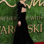 The 22-year-old star chose a quirky black velvet and mesh gown embellished with Swarovski crystals for the 2017 British Fashion Awards. (Photo: WENN)