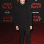 """The force was strong with the """"Stranger Things"""" star at """"The Last Jedi"""" premiere, where he rocked a head-to-toe black look paired with cool gray sneakers. (Photo: WENN)"""