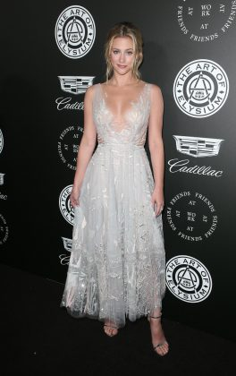 Lili Reinhart looked angelical in a charming silver tulle and lace V-neck A-line dress at the Art of Elysium's Heaven 2018 celebration. (Photo: WENN)