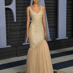 Zendaya Coleman headed over to the 2018 Vanity Fair Oscars party wearing a nude custom Michael Kors gown with a glamorous sparkly tulle fishtail. (Photo: WENN)