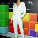 "Miss Z stepped out modeling a sporty white jumpsuit at the Boohoo Block Party in celebration of her new fashion line ""The Zendaya Edit."" (Photo: WENN)"