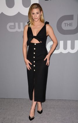 The 22-year-old actress smoldered in a stylish black dress with sexy midriff cut-out and snug pencil skirt with white buttons down the center at the 2018 CW upfronts. (Photo: WENN)