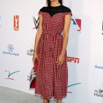 Emmy plaid it up in a retro-chic feminine Fendi black and red ankle-length dress at the 2018 Annual Sports Humanitarian Awards. (Photo: WENN)