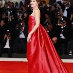 """Dakota Johnson oozed elegance in a classic strapless red sating Dior Couture dress at the screening of her movie """"Suspiria."""" (Photo: WENN)"""