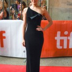 "Emmy Rossum was sleek and elegant in a black silky long one-shoulder column dress at the TIFF premiere of ""Homecoming."" (Photo: WENN)"