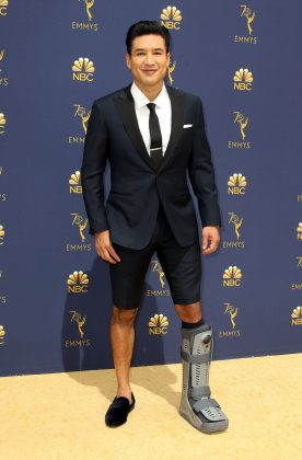 After injuring himself on July 4th, Mario Lopez was sort-of forced to attend a fancy celebrity event like the 2018 Emmys wearing formal shorts with loafers and a boot. (Photo: WENN)q