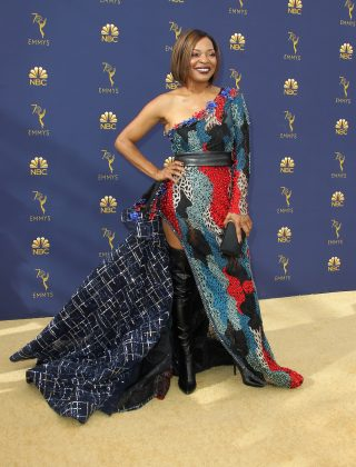 We love a statement gown, but Tina Lifford's one-sleeve gown featuring a mish-mash of prints and colors, along with a high slit, a leather belt, and a bulky train was just too much! (Photo: WENN)