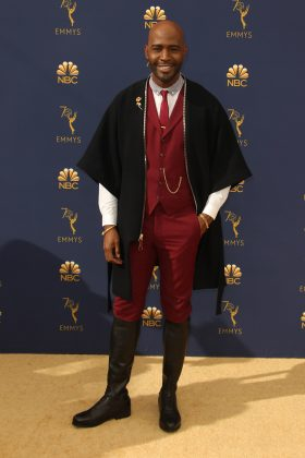 Karamo Brown's marroon suit and black cape time-traveler inspired combo would've been much batter if he had ditched the riding boots. (Photo: WENN)
