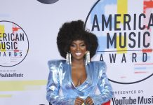 We love a good power suit, but Amara la Negra's head-to-toe shinny blue + tailcoat was a little too much. (Photo: WENN)