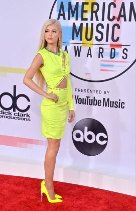 YouTube star Loren Gray made sure she REALLY stood out wearing a headache-inducing highlighter-yellow look. (Photo: WENN)
