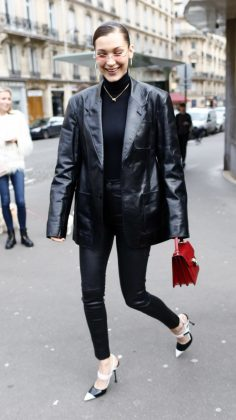 The Hadid sister was spotted shopping in Paris in a head-to-toe black outfit, consisting of a leather jacket, tight pants, black and white pumps and a contrasting red purse. (Photo: WENN)
