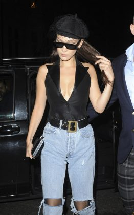 Bella wore a plunging black leather halter top paired with a bulky matching belt cinching her ripped mom jeans and a vintage beret to complete the look. (Photo: WENN)