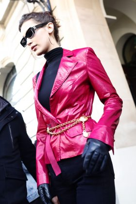 Bella Hadid was spotted leaving the Cafe Flore in Paris wearing a simple black turtleneck underneath a Georgine Abbe rose leather blazer and a dainty gold belt. (Photo: WENN)