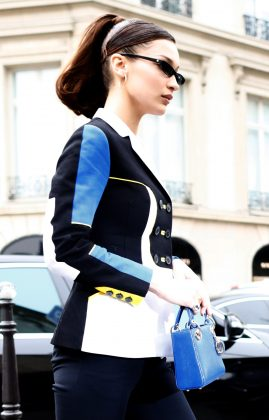 Hadid looked ultrachic as she strolled the streets of Paris wearing a geometric black, white, blue and yellow blazer paired with matching cobalt blue purse. (Photo: WENN)