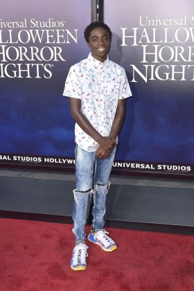 "Caleb opted for a casual look at the opening night celebration of ""Halloween Horror Nights"" wearing a short-sleeved white button-up with ripped jeans. (Photo: WENN)"