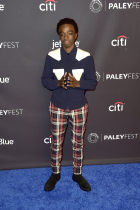 "McLaughlin showed off his eclectic style wearing a two-tone button up shirt and plaid pants with black ankle boots at the PaleyFest screening of ""Strange Things."" (Photo: WENN)"