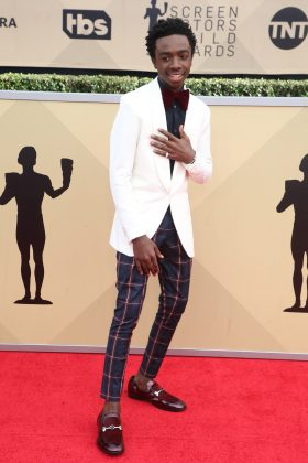 The Netflix star donned a white Louis Vuitton jacket paired with Antonio Marras plaid pants, and burgundy Jimmy Choo shoes at the 2018 SAG Awards red carpet. (Photo: WENN)