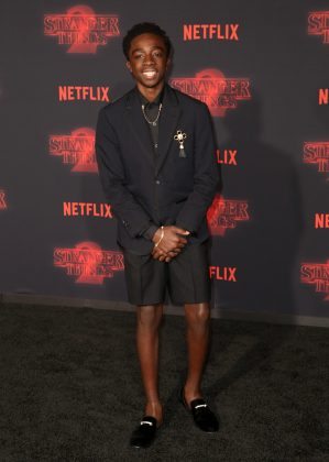"The ""Stranger Things"" actor hit the premiere of the show's second season wearing a black Thom Browne short suit paired with matching velvet loafers. (Photo: WENN)"