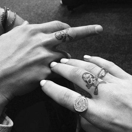 Former flames Ellie Goulding and Dougie Pynter showed off their matching middle finger skulls on Instagram, only to break up one year later. (Photo: Instagram)