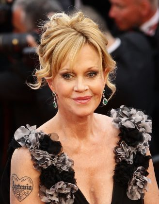Melanie Griffith had husband Antonio Banderas' name tattooed inside a heart in the 90's. But after the couple split, she decided the sentiment no longer held. (Photo: Instagram)