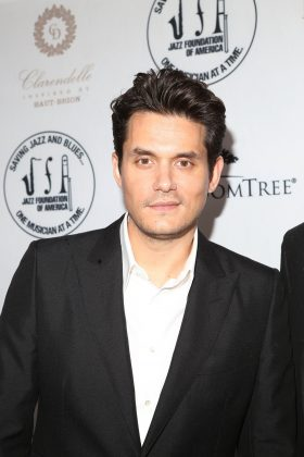 "John Mayer's epic guitar-playing ""O"" face may be his most famous facial expression, but his crooked smile will be what you notice from now on. (Photo: WENN)"