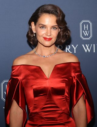 "Online commenters have dubbed the signature asymmetrical grin that Katie Holmes made famous back during her ""Dawson's Creek"" days as the ""half smile."" (Photo: WENN)"