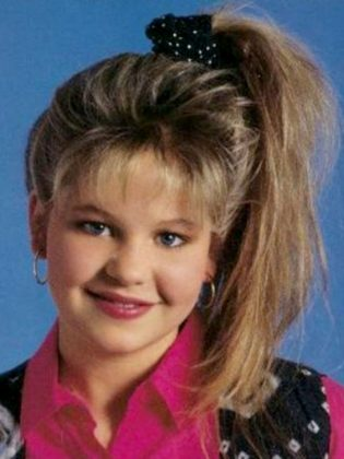 DJ Tanner's high side, messy ponytail. (Photo: Release)