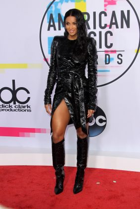 Ciara looked sexy AG in a skintight black alligator-inspired dress and boots as the attended the 2017 American Music Awards. (Photo: WENN)