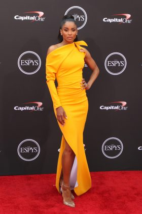 Ciara shined at the 2018 ESPYS in a radian, canary yellow dress with an interesting neckline and thigh high slit that flaunted her toned legs. (Photo: WENN)