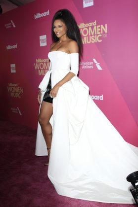 Ciara hosted the Billboard Women in Music Awards 2018 wearing a long white off-the-shoulders dress with short black leather skirt. (Photo: WENN)