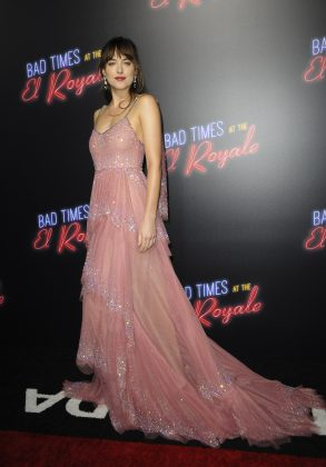 "Dakota Johnson stepped out for the premier of her new film ""Bad Times at the El Royale"" looking ethereal in a sparkly pink Gucci gown with long trail. (Photo: WENN)"